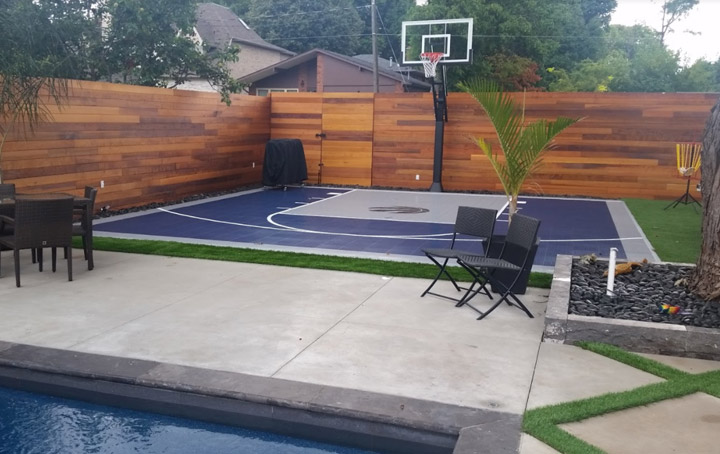 Basketball Back yard court in Etobicoke with raptors Logo.