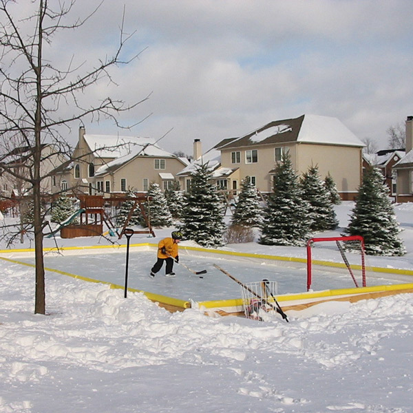 Kid practicing in backyard ice rink