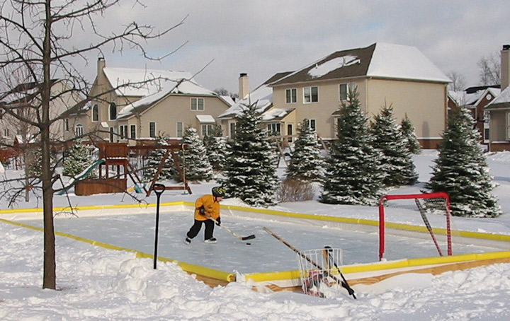 Kid practicing on his backyard ice rink